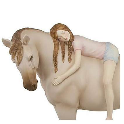 A horse collectible featuring a girl on laying on her horse's back giving the horse a hug.