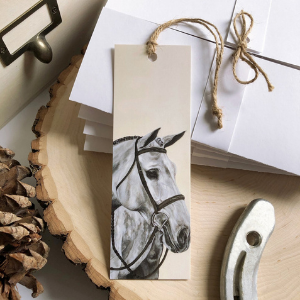 A bookmark with a horse head design on it.