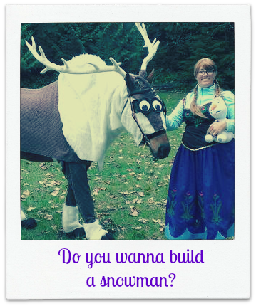 A horse dressed up as the reindeer Sven from the movie Frozen being held by a woman dressed up as Elsa from the same movie. The woman is also holding a stuffed snowman.