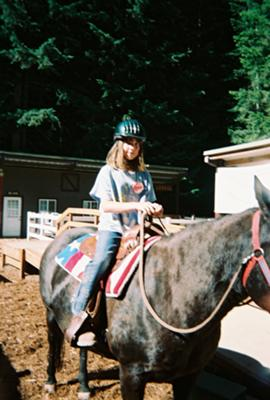 me on a horse named cherry my fav horse at a camp i went 2